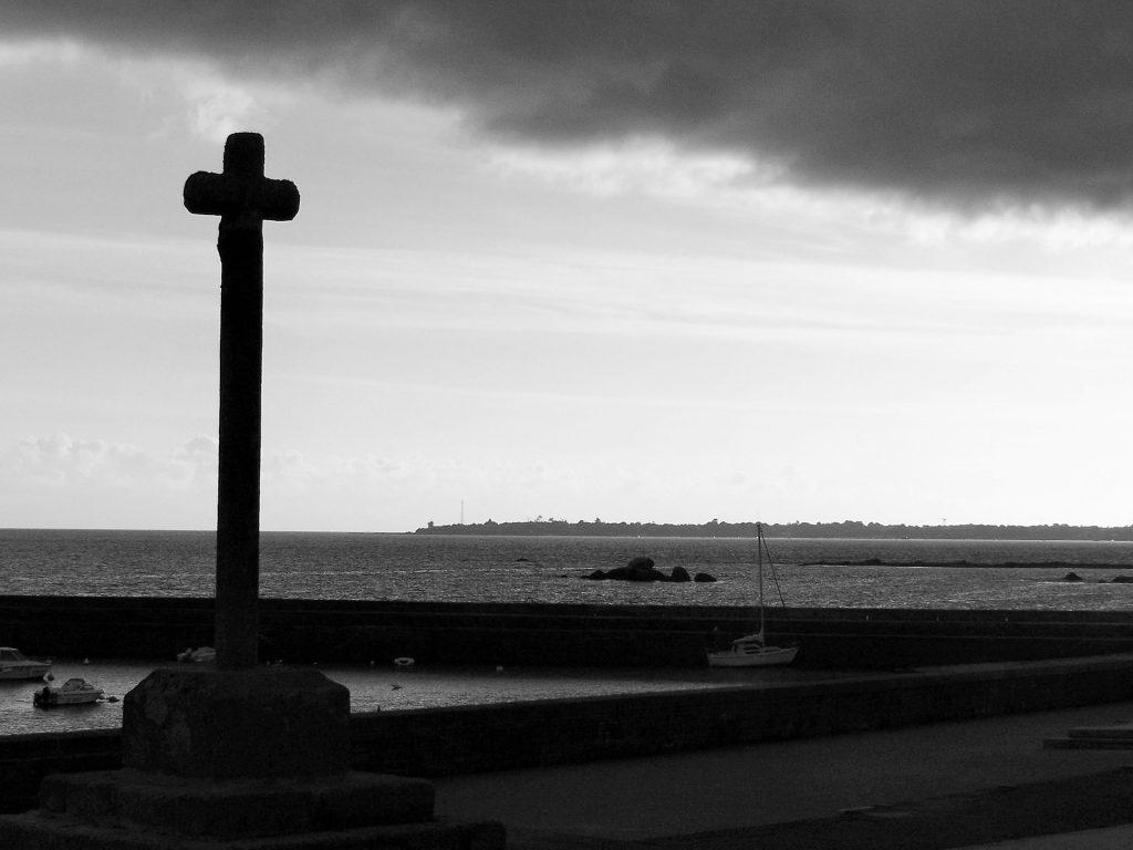 a cross facing the sea